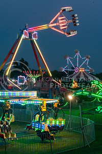Fair rides and attractions light up for the Riley County Fair on July 21, 2016 at the Riley County Fairgrounds in CiCo Park. (Evert Nelson | The Collegian)