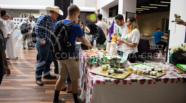 Students try different foods custom to Saudi culture for National Day of Saudi Arabia in the K-State Student Union courtyard on Oct. 6, 2016. (Miranda Snyder | The Collegian)