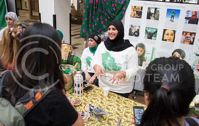 Lama Alanazi, junior in interior design, tells students about the many achievements of Saudi women at the National Day of Saudi Arabia celebration in the K-State Student Union courtyard on Oct. 6, 2016. (Miranda Snyder | The Collegian)