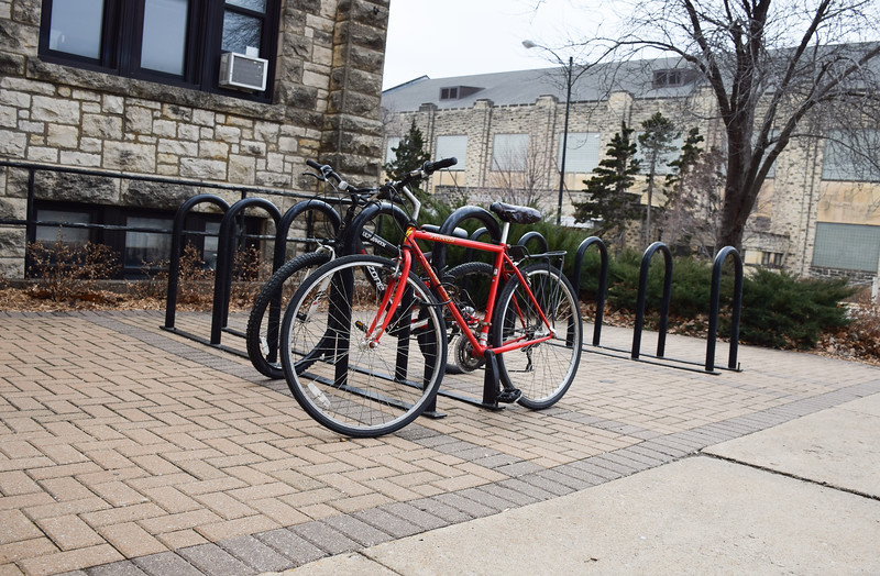 Bikes are locked onto bike racks on campus after students had ridden them to class.