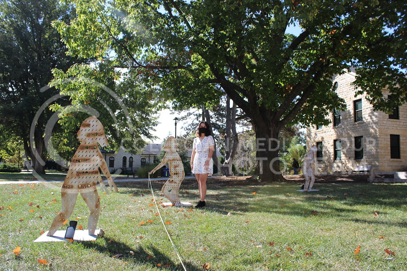 "Selena Hernandez's senior art installation, a series of 10 silhouettes titled ""Aquí Estamos De Pie,"" is currently on display on Coffman Commons right next to Hale Library. (Rebecca Vrbas 