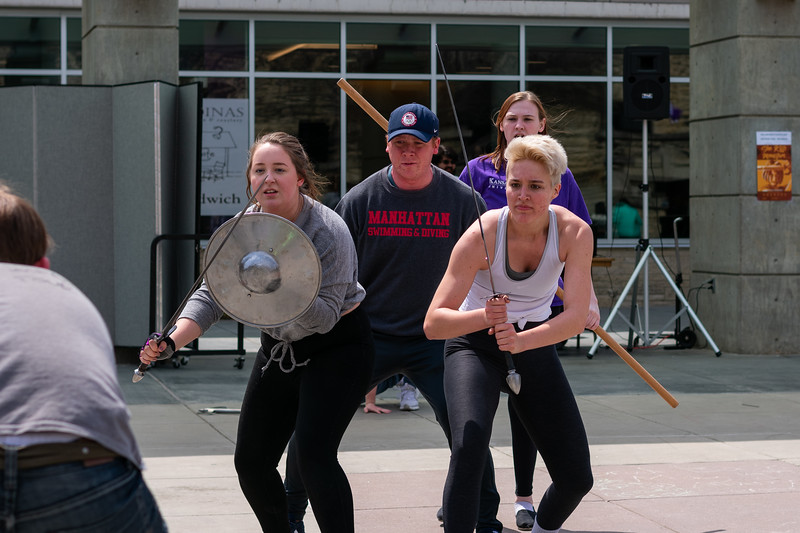 "Cast members of ""She Kills Monsters"" performed a choreographed fight scene in the Union Plaza on April 20, 2018. The final play of the season features a ""Dungeons and Dragons"" motif and is showing April 19-21 and April 26-28 in the Mark A. Chapman Theatre in Nichols Hall. (Alex Todd 