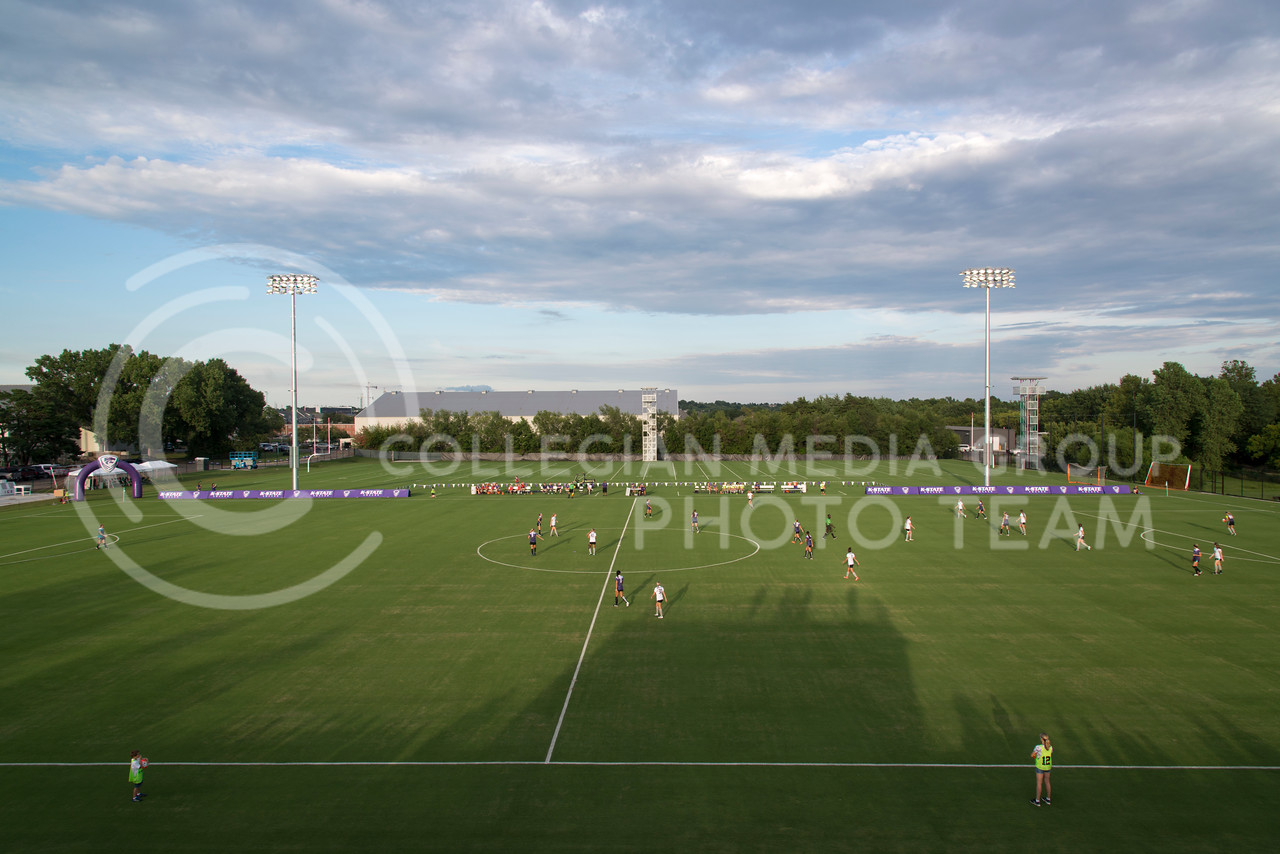 The sun sets over the K-State Soccer Complex as the Wildcats scrimmage on August 6, 2016 to an excited crowd at the K-State Soccer Complex. This was the first show of the Wildcats and ended in a 2-0 win for the White team. (Evert Nelson | The Collegian)
