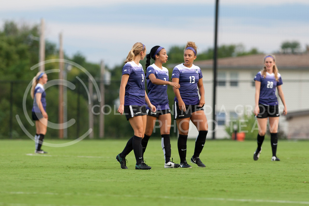 Purple teammates walk back on the field after the first half of play at the Wildcats scrimmage on August 6, 2016 at the K-State Soccer Complex. White defeated Purple 2-0. (Evert Nelson | The Collegian)