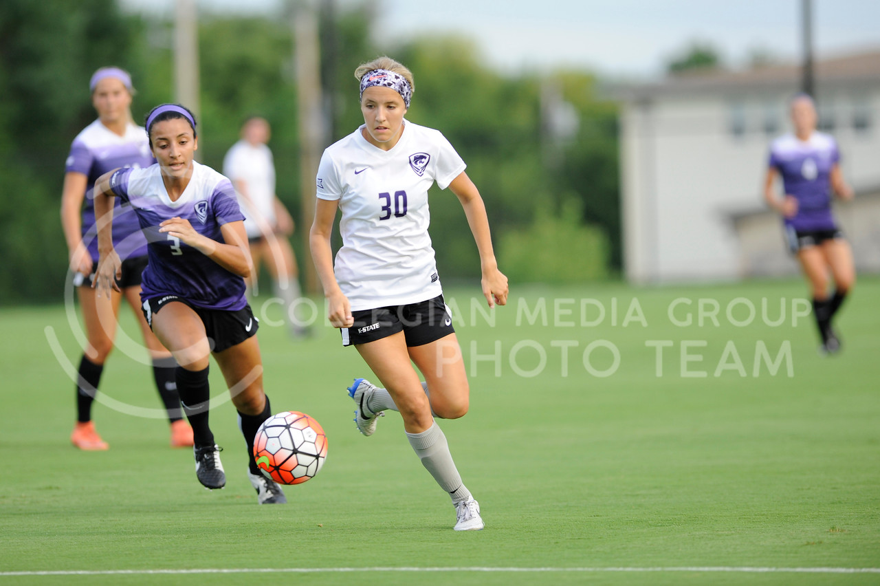 Bridget Howard, freshman, looks to keep the ball away from Hali Sutter, sophomore, during the Wildcats scrimmage on August 6, 2016 at the K-State Soccer Complex. White defeated purple 2-0. (Evert Nelson | The Collegian)