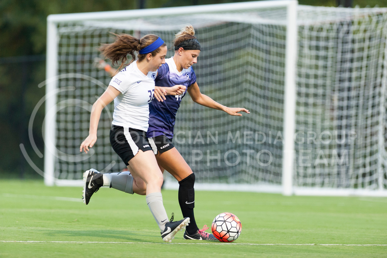 Tatum Wagner, sophomore forward, tries to hold position of the ball while Morgan Mauck, sophomore midfielder, swoops in during the Wildcats scrimmage on August 6, 2016 at the K-State Soccer Complex. White beat Purple 2-0. (Evert Nelson | The Collegian)