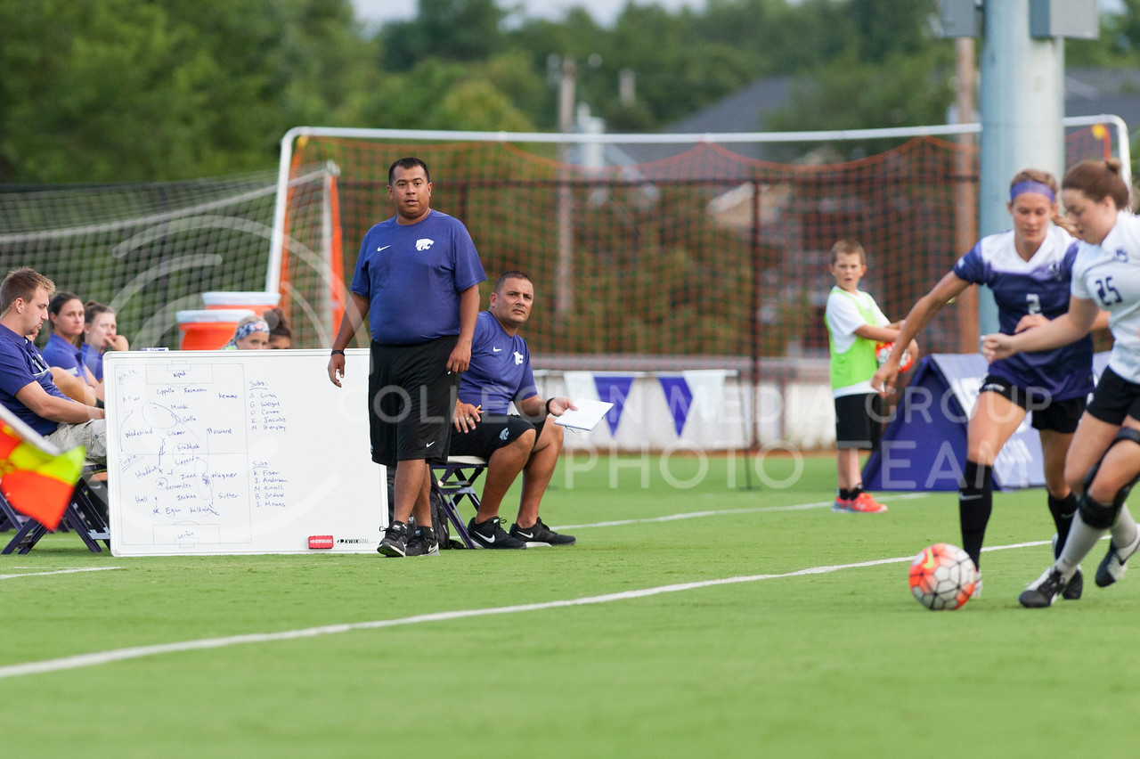 Head coach Mike Dibbini and assistant coach Gabe Romo watch the Wildcats during their scrimmage on August 6, 2016 at the K-State Soccer Complex. (Evert Nelson | The Collegian)