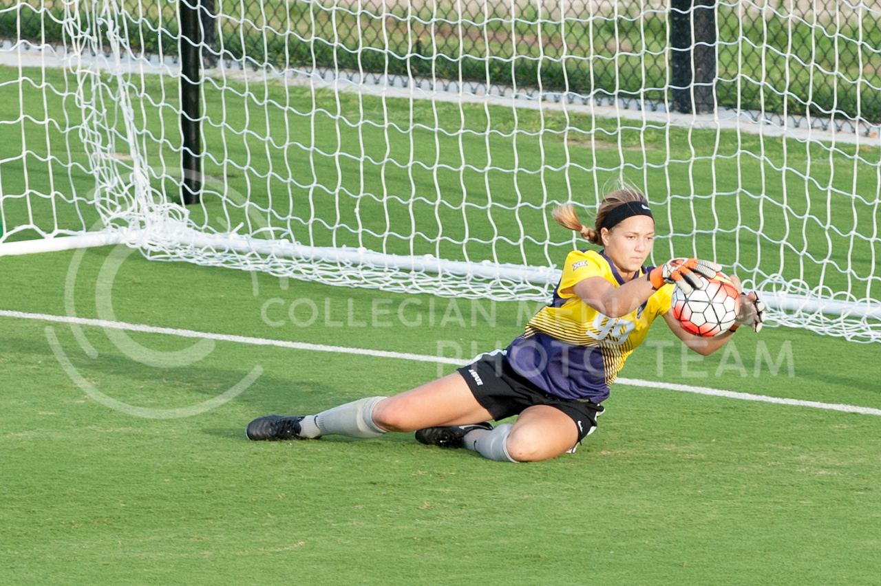 And Wench, freshman goalie, saves a goal during the Wildcats scrimmage on August 6, 2016 at the K-State Soccer Complex. White defeated Purple 2-0. (Evert Nelson | The Collegian)