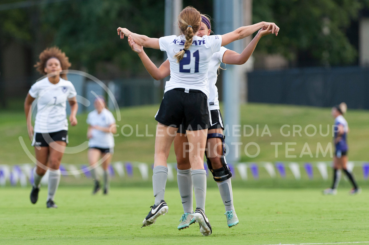 Madison Wedekind, #21 junior, celebrates with teammates after scoring the first goal of the scrimmage on August 6, 2016 at the K-State Soccer Complex. White defeated Purple 2-0. (Evert Nelson | The Collegian)