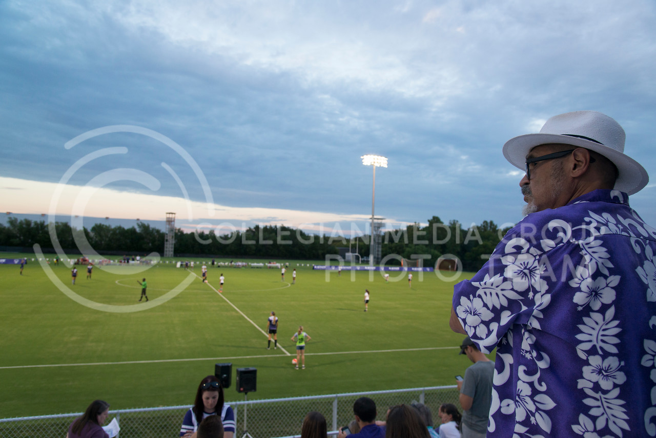 A spectator watches the Wildcats scrimmage at the K-State Soccer Complex on August 6, 2016. White defeated Purple 2-0.(Evert Nelson | The Collegian)
