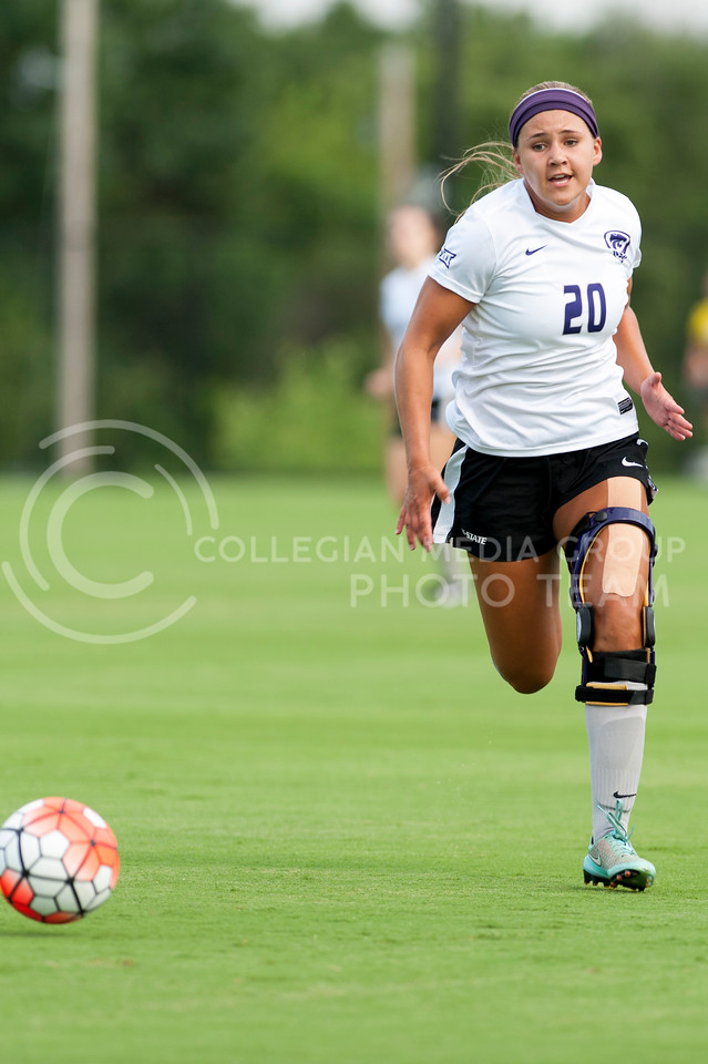 Katie Cramer, freshman forward, catches up to the ball during the purple-white scrimmage at the K-State Soccer Complex on August 6, 2016. White defeated Purple 2-0. (Evert Nelson | The Collegian)