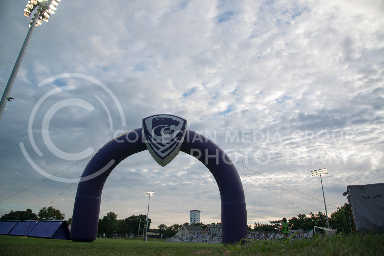 The archway to the K-State Soccer Complex turns to shadow as the Wildcats scrimmage purple and white teams on August 6, 2016. (Evert Nelson | The Collegian)