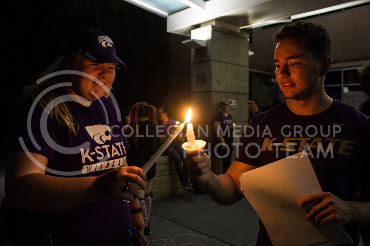 Students light candles at a solidarity rally held in Bosco Plaza on Sept. 14. The rally was held in response to white nationalist posters were seen on campus. (Regan Tokos   Collegian Media Group)