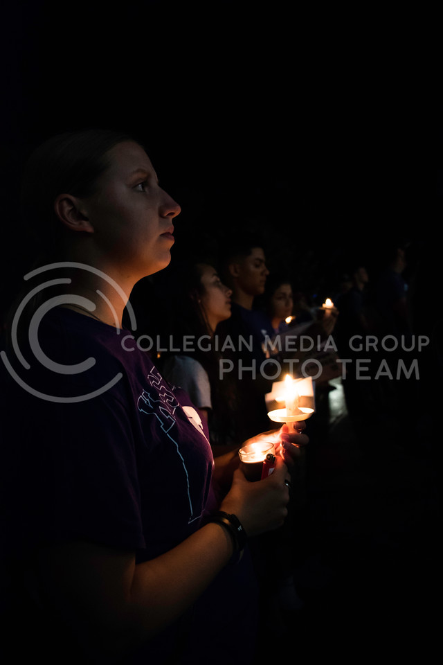 Students gather in candlelight at the Stand in Solidarity rally. The rally was held in Bosco Plaza Sept. 14, 2017. (Olivia Bergmeier | Collegian Media Group)
