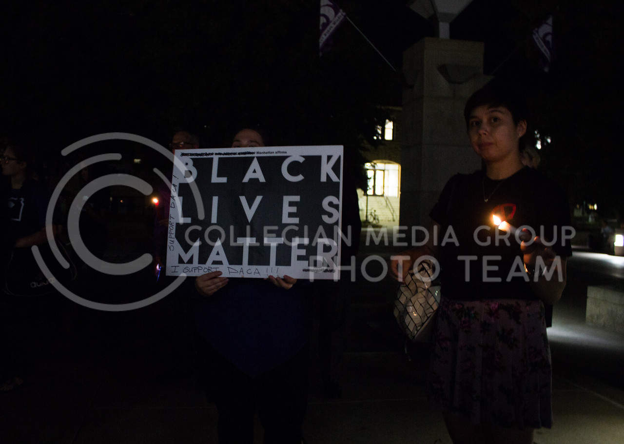 Students hold a Black Lives Matter sign at a solidarity rally held in Bosco Plaza on Sept. 14. The rally was held in response to white nationalist posters were seen on campus. (Regan Tokos   Collegian Media Group)