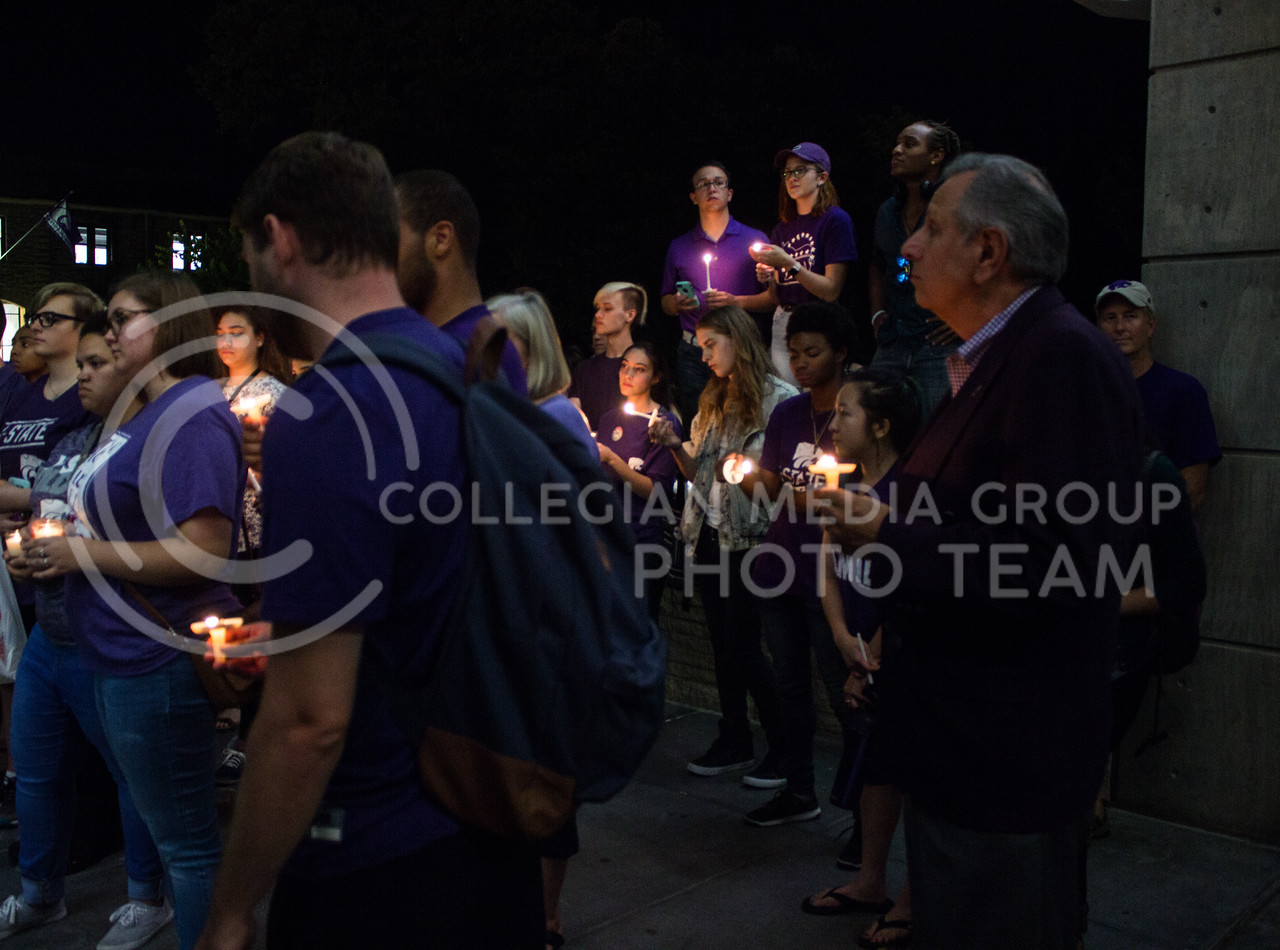 Dr. Bosco, Vice President of Student Life, stands with students at a solidarity rally held in Bosco Plaza on Sept. 15. The rally was held in response to white nationalist posters were seen on campus. (Regan Tokos   Collegian Media Group)
