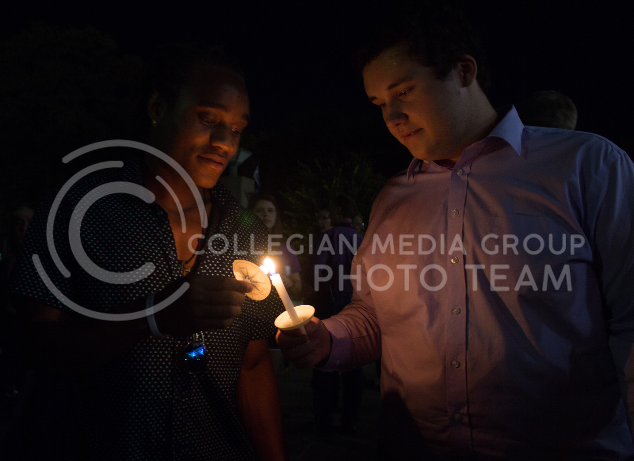 Students light candles at a solidarity rally held in Bosco Plaza on Sept. 14. The rally was held in response to white nationalist posters were seen on campus. (Regan Tokos | Collegian Media Group)