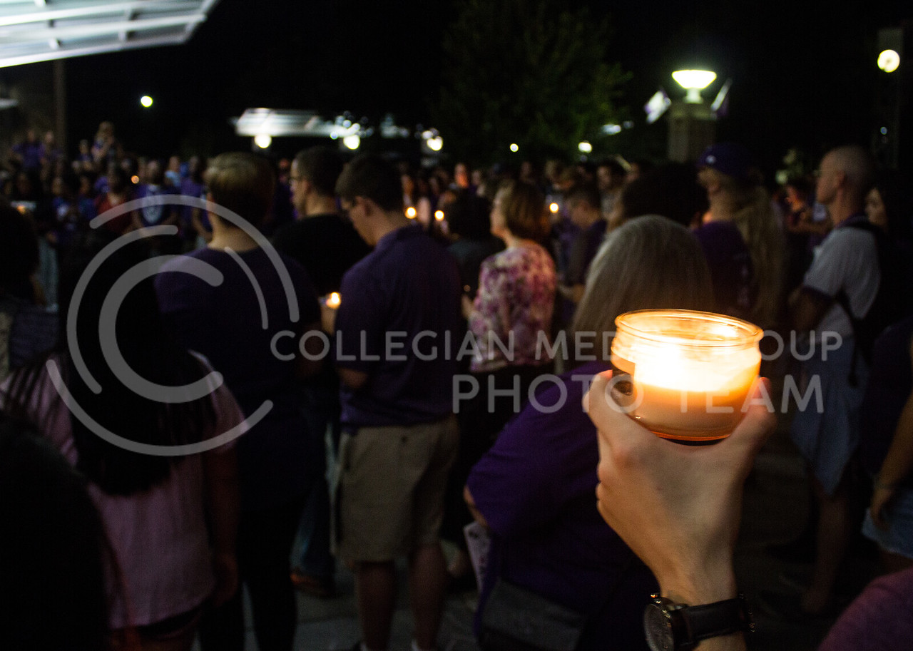 A student holds a candle at a solidarity rally held in Bosco Plaza on Sept. 14. The rally was held in response to white nationalist posters were seen on campus. (Regan Tokos | Collegian Media Group)
