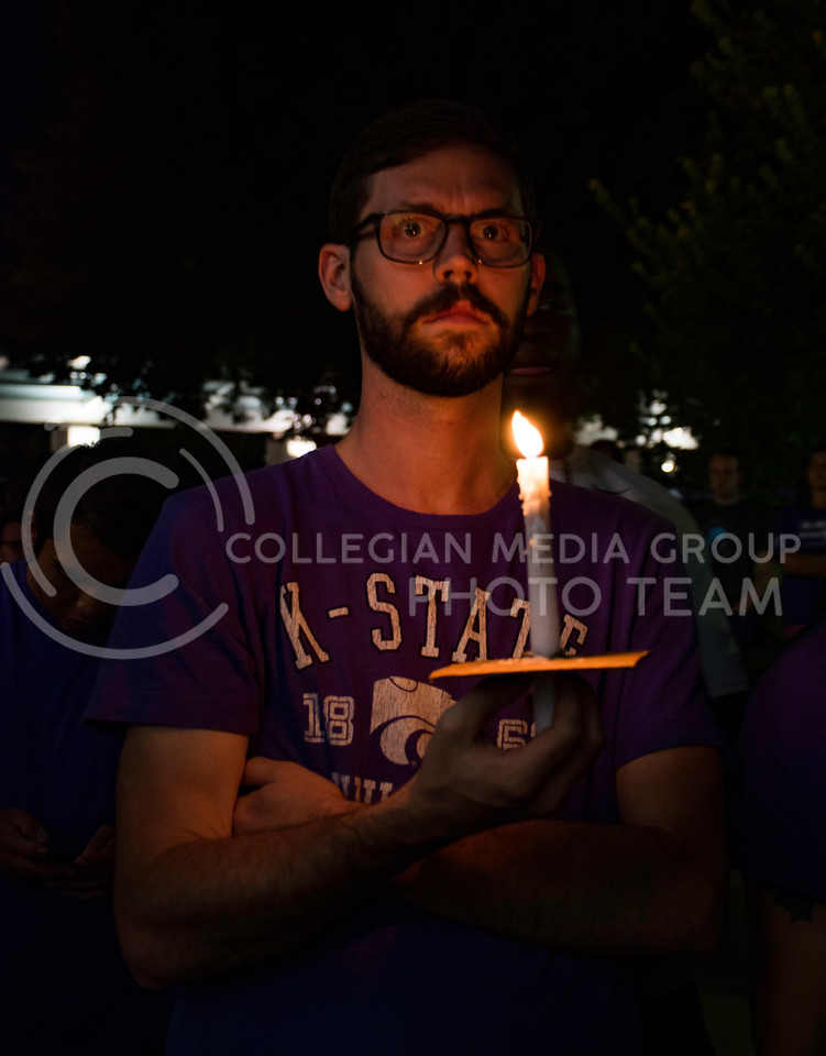 Rally attendees held candles at Bosco Plaza in response to the White Nationalist posters posted on campus. The rally was held in Bosco Plaza on Sept. 14, 2017. (Olivia Bergmeier | Collegian Media Group)