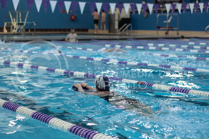 Anne Criddle, junior here at Kstate, on top of a float swimming her cool down lap with the  K-State Swim Club on feb 24th, 2020. (Sreenikhil Keshamoni | Collegian Media Group)
