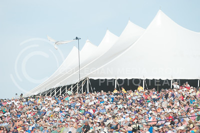 Around 5,000 people sit outside the main stage to enjoy the Kansas City Symphony at Symphony In The Flint Hills on June 11, 2016.