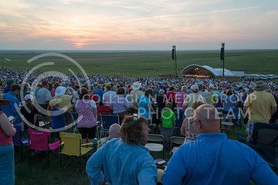 The sun sets during the final songs played by the Kansas City Symphony during the 11th Annual Symphony In The Flint Hills on June 11, 2016. (Photo by Evert Nelson | The Collegian)