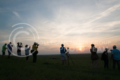 Patrons take to the west of the stage during the last part of the Kansas City Symphony's performance during the Symphony In The Flint Hills on June 11, 2016 to capture photos of the sunset across the prarie. (Photo by Evert Nelson | The Collegian)