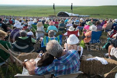 A couple embraces while taking in the experience of listening to the Kansas City Symphony perform at the Symphony In The Flint Hills in Chase County on June 11, 2016. Five thousand tickets were sold for the 11th Annual Signature Event. (Photo by Evert Nelson | The Collegian)
