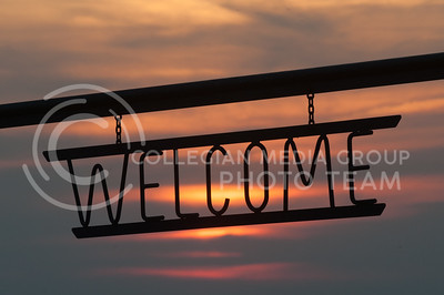 A metal sign above the entrance to the main stage and seating invites patrons who came out to enjoy the Symphony In The Flint Hills in Chase County on June 11, 2016. (Photo by Evert Nelson | The Collegian)