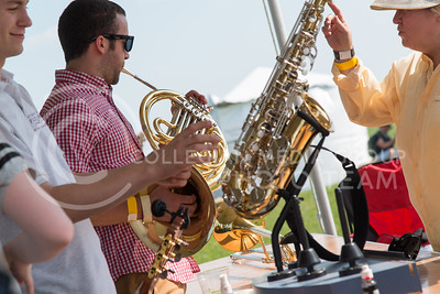 Dylan Wheeler, senior in english at K-State, trys out a French Horn in the Musical Instrument Petting Zoo at the Symphony In The Flint Hills on June 11, 2016. (Photo by Evert Nelson | The Collegian)