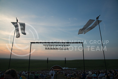A welcoming sign above the entrance to the main stage and seating invites patrons who came out to enjoy the Symphony In The Flint Hills in Chase County on June 11, 2016. (Photo by Evert Nelson | The Collegian)