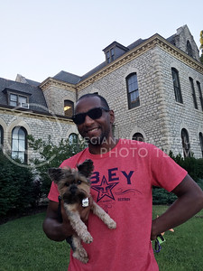 "Alfred Jackson, Manhattan resident, holds Duchess, a toy yorky outside of Anderson Hall on June 28, 2016. ""She's a whooping four pounds,"" Jackson said. ""She's actually my girlfriends dog. I defininlty would have ended up with a bigger dog."" (Photo by Evert Nelson 