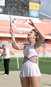 A K-State twirler tosses a baton during the pep rally at the BBVA Compass Stadium in Houston, Texas on Dec. 27, 2016. (George Walker | The Collegian)