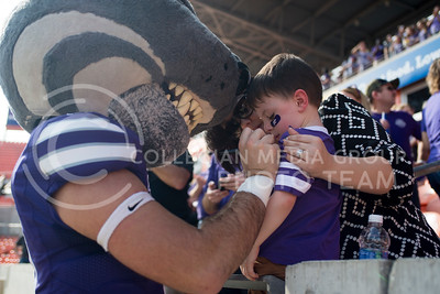 Willie the Wildcat signs a fan during the pep rally at the BBVA Compass Stadium in Houston, Texas on Dec. 27, 2016. (George Walker | The Collegian)