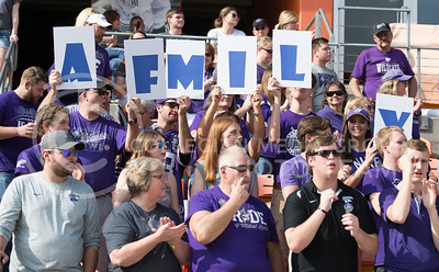 "K-State fans hold up the letters to ""FAMILY"" during the pep rally at the BBVA Compass Stadium in Houston, Texas on Dec. 27, 2016. (George Walker 