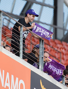A K-State fan holds a Wildcat sign during the pep rally at the BBVA Compass Stadium in Houston, Texas on Dec. 27, 2016. (George Walker | The Collegian)