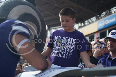 Willie the Wildcat signs a poster during the pep rally at the BBVA Compass Stadium in Houston, Texas on Dec. 27, 2016. (George Walker | The Collegian)