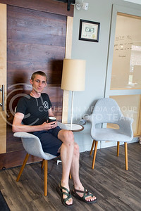 Josh Hicks, founder of The Fellow MHK, sits in one of his favorite spots of the establishment on July 12, 2016. The Fellow is open Monday through Friday, 8 a.m. to 6 p.m., but with a membership there is 24/7 access. (Sarah Falcon | The Collegian)