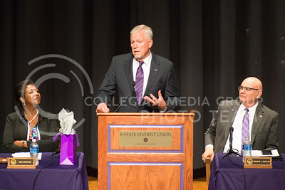 General Richard Myers speaks in between Dennis Mullin and Zoe Newton after he was announed the 14th President of Kansas State University on Nov. 11, 2016. in Forum Hall. (Evert Nelson | The Collegian)