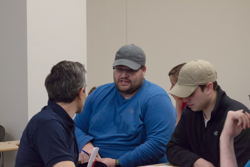 Daniel Warner, a graphic design professor, talks with two juniors in graphic design, Brett Bolf and Thomas Holscher, before Tony Snethen's lecture on Thursday, April 19th. (Sarah Millard | Collegian Media Group)
