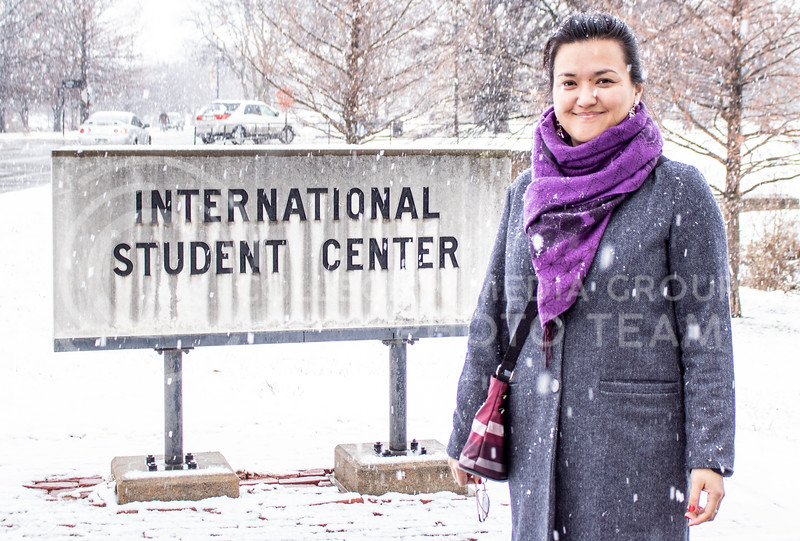 Alina Sadykova, a graduate student here at K-State studying Criminology, who is an international student standing in front of the International Student Center Building on campus. (Sreenikhil Keshamoni | Collegian Media Group)