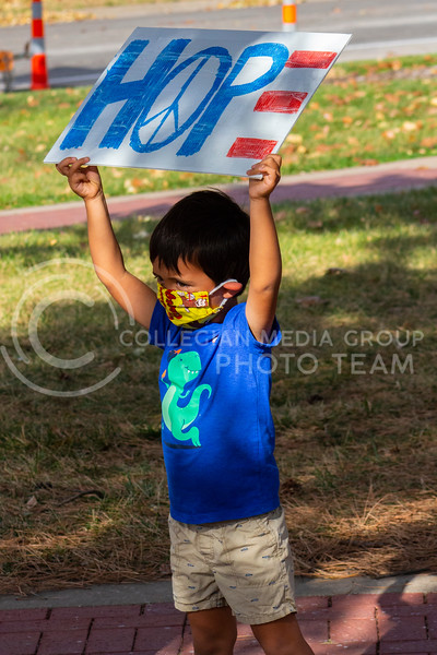 """A child holds up a """"HOPE"""" sign at an event held by the Black Lives Matter movement in Triangle Park on November 8th 2020 to celebrate Joe Biden and Kamala Harris winning the 2020 Presidential election. The members also discussed upcoming BLM events and ways for members to show support. (Dalton Wainscott I Collegian Media Group)"""