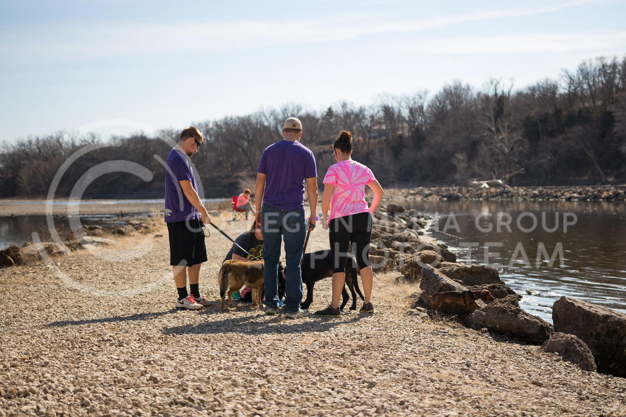 Tuttle Trek attendees stand with their dogs at Rocky Ford fishing area at the Tuttle Trek event on Feb 18, 2017. (John Benfer | The Collegian)