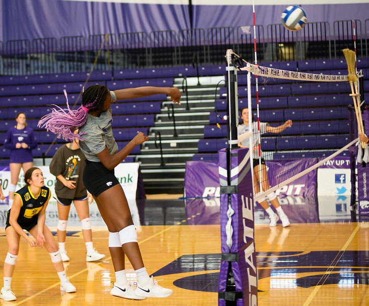 Gloria Mutiri spikes the ball during a practice at Ahearn Fieldhouse. Gloria is a  Sophomore for KSU Volleyball team, studying Mass Communications. Gloria is positioned opposite of the setter. Oct 18, 2019. (Dylan Connell | Collegian Media Group)