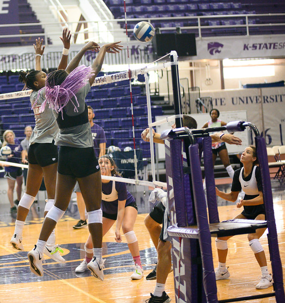 Gloria Mutiri blokes a spike during a practice at Ahearn Fieldhouse. Gloria is a  Sophomore for KSU Volleyball team, studying Mass Communications. Gloria is positioned opposite of the setter. Oct 18, 2019. (Dylan Connell | Collegian Media Group)