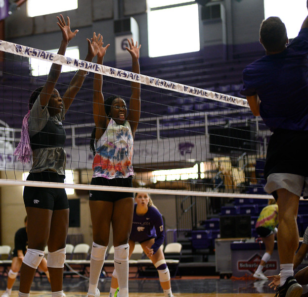Gloria Mutiri attempts a bloke during a practice at Ahearn Fieldhouse. Gloria is a  Sophomore for KSU Volleyball team, studying Mass Communications. Gloria is positioned opposite of the setter. Oct 18, 2019. (Dylan Connell | Collegian Media Group)