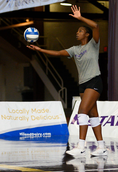 Gloria Mutiri prepares to serve the ball during a practice at Ahearn Fieldhouse. Gloria is a  Sophomore for KSU Volleyball team, studying Mass Communications. Gloria is positioned opposite of the setter. Oct 18, 2019. (Dylan Connell | Collegian Media Group)