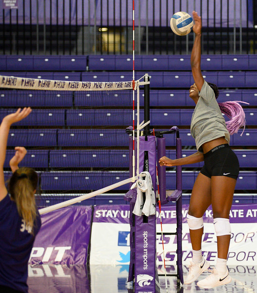 Gloria Mutiri spikes the ball during a practice at Ahearn Fieldhouse. Gloria is a  Sophomore for KSU Volleyball team, studying Mass Communications, Gloria is positioned opposite of the setter. Oct 18, 2019. (Dylan Connell | Collegian Media Group)