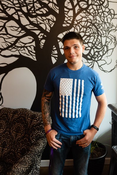 Chris Vitols, a junior studying clincial psychology, poses at Sparrow Coffee after an interview of his experiences while serving in the Army on June 21, 2018. (Olivia Bergmeier | Collegian Media Group)