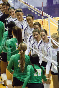 The K-State volleyball team high-fives its opponents in the game against Baylor on Oct. 29, 2016, in Ahearn Field House. (Maddie Domnick | The Collegian)